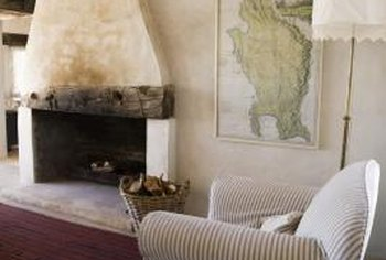 Placing mismatched chairs around a central feature like a fireplace can help create a unified arrangement.