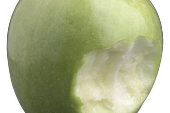 """Granny Smith"" apples have a green to yellow skin color and crisp flesh."