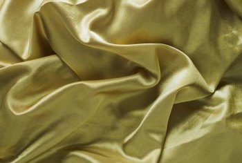 Satin sheets can be held in place with fasteners and straps.