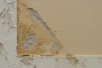Crumbling wall paint must be removed to properly refinish the wall.