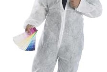 Disposable painter's coveralls protect clothing.