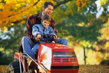 Dimming riding lawnmower headlights indicate a weak battery.