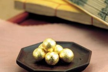 Cover plain items with gold leaf to create expensive-looking ornaments.