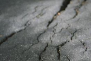 Keep your sidewalk safe, and maintain your home's property value, by patching up cracks.