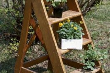 A small stepladder can be refinished, painted or used as is to hold potted plants.