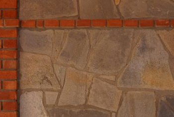A faux finishing technique can create the appearance of river rock on a fireplace.