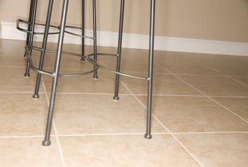 Removing dried mastic from tiles is easiest when done soon after the adhesive dries.