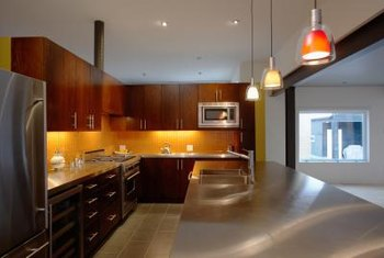 Pendant lights bring fashion and functionality to a kitchen island space.