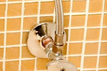 Shower valves have to be cut around to allow space for the pipes.