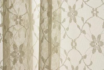 French country curtains can be both functional and romantic in style.