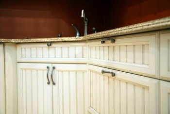 A mild vinegar solution cleans beadboard cabinets.