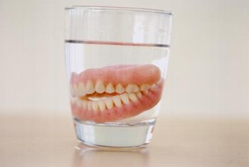 Complete dentures replace missing teeth in a mouth.