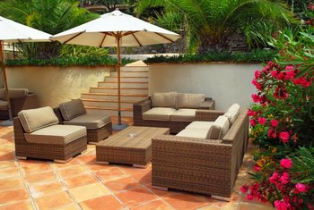 Mottled Spanish tiles make a decorative choice for patio flooring.