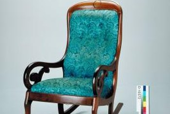 Go vintage with a rocking chair featuring carved wood and upholstered seats.