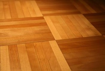 Using Varathane Renewal is a good way to brighten up your wood floor without sanding.
