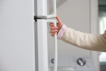 Reversing your refrigerator door opening may make the fridge more convenient. & How to Reverse the Door Opening on a Frigidaire Refrigerator ... Pezcame.Com