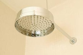 Ceilings that come within 3 inches of a showerhead must be tiled by code.