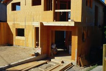 Protect OSB sheathing with a waterproof barrier before installing vinyl siding.