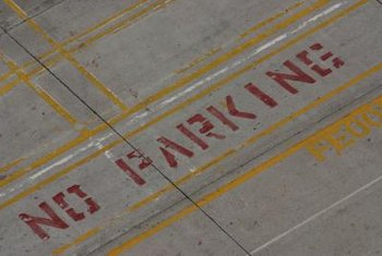 """No parking"" stripes help keep areas clear for other uses in a parking lot or on a street."