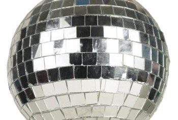 A mirrored ball is a must if you really want your disco-themed room to come alive.