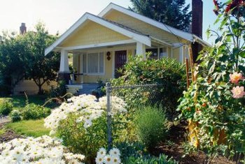 Tall shrubs on either side of a house create a framing effect.