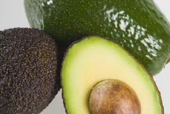 An avocado's skin changes color and texture as the fruit ripens.