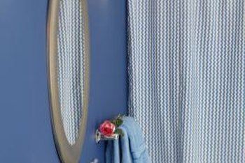A spring-loaded shower curtain rod is an ideal solution for awkward bathroom spaces.