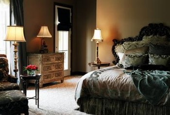 Lavish furnishings and an ornate headboard create an elegant ambiance.