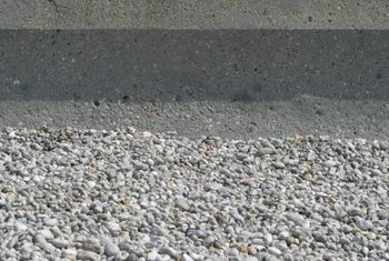 Layers of gravel, concrete and mortar compose the footing under paver steps.