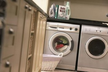 A simple alcove is an ideal spot to create a laundry room in your kitchen.