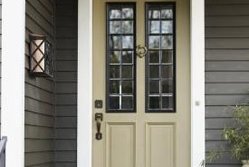 The door's finish trim molding will cover imperfect cuts in the vinyl.