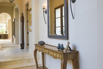 Keep a hallway console table free of clutter by minimizing decorative accessories.