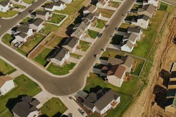 An aerial view of suburban homes shows their exterior uniformity.
