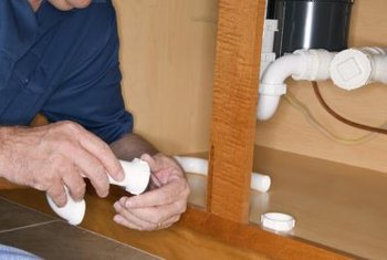 You can usually hand-tighten plastic drain pipes.