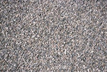 Gravel driveways are attractive, but not when grass grows through.