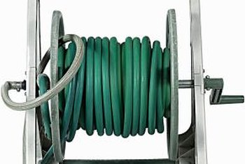 Wheel the garden hose wherever it is needed on a hose reel cart.