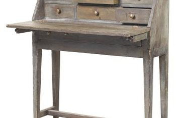 The 19th century writing desk evolved from the 18th century writing box, which the owner could fold and move from place to place.