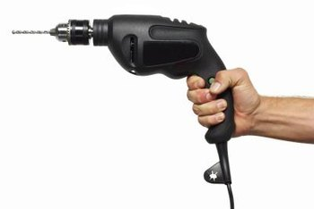 Use a power drill and screw-tip attachment when a cordless drill is not available.