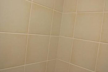 Installing a soap dish requires removing wall tiles.