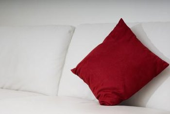 Adding throw pillows helps to visually connect mismatched furniture pieces.