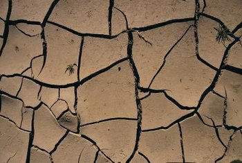 Clay soil that has cracks is dry and will be hard to dig.