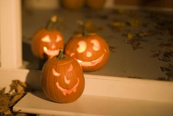 Candles give carved pumpkins an inner glow.