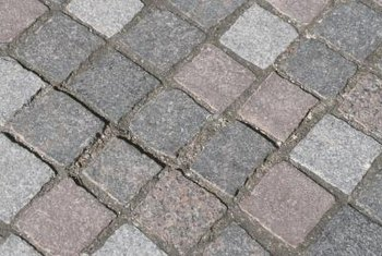 Twelve-inch brick pavers serve a variety of purposes in your garden.