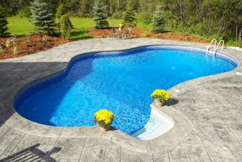Swimming pool liners provide a smooth surface over concrete for in-ground pools.
