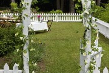 Arched trellises make inviting doorways in outdoor fences.