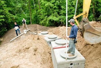 A septic system should be 100 feet from surrounding trees.