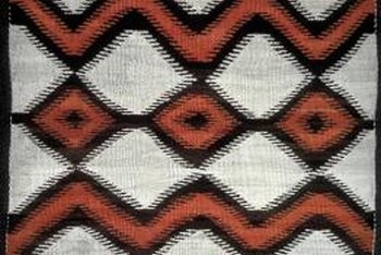 A Navajo blanket adds graphic appeal as a wall hanging.
