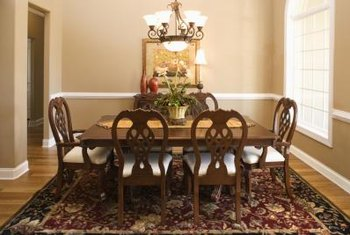 size for a dining room an area rug defines the space - Dining Room Rug Size