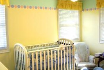 Stencils add cheerful borders to the baby's room.