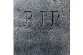 Create fabric or cardboard tombstone covers for Halloween chair decor.